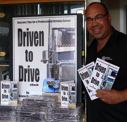 Bruce with his book Driven to Drive