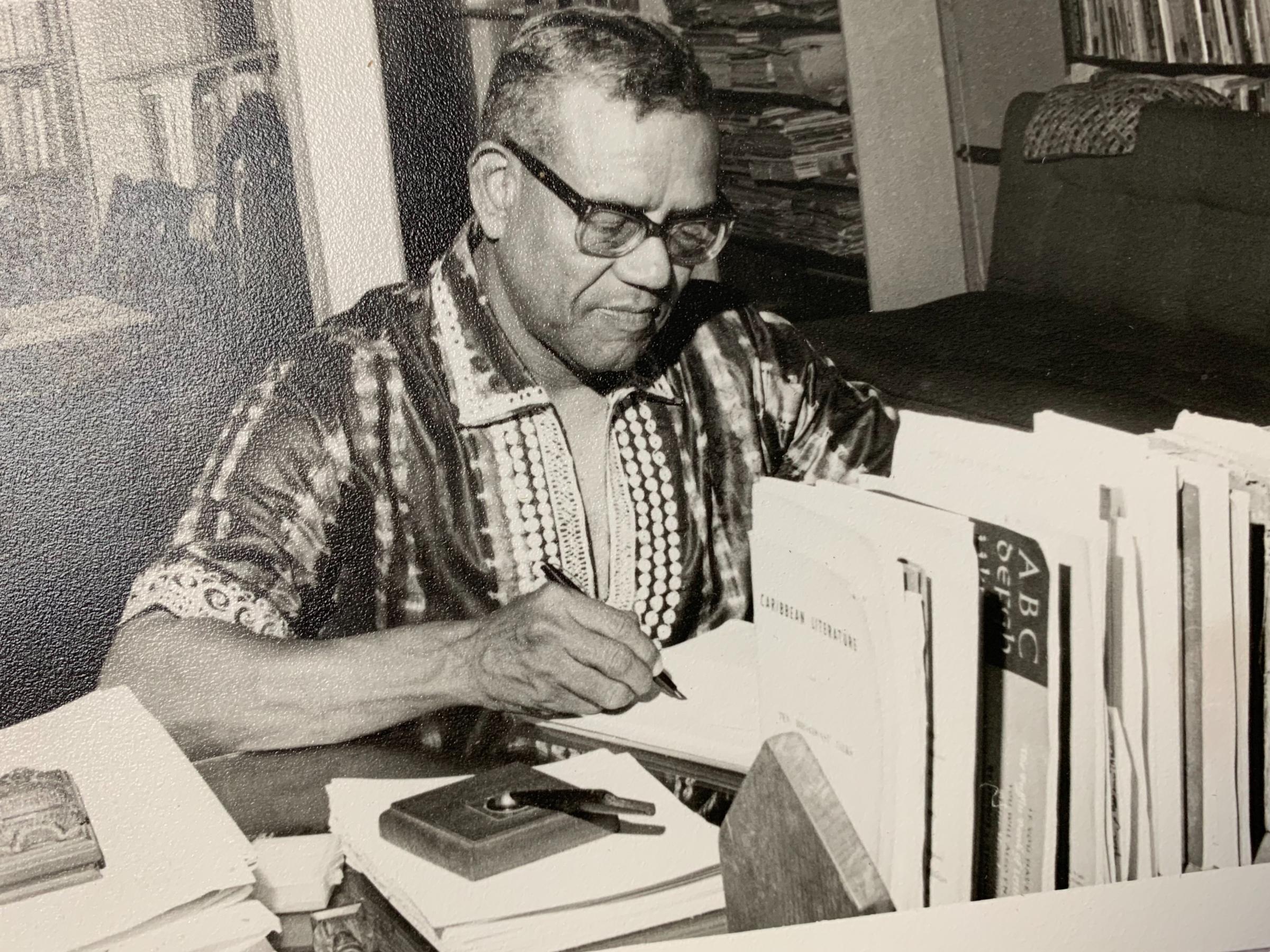 AJ Seymour at desk
